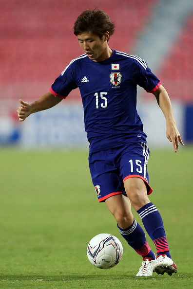 BANGKOK, THAILAND - DECEMBER 14: Masashi Kamekawa of Japan runs with the ball during the friendly international match between Japan U21 and Thailand U21 at Rajamangala Stadium on December 14, 2014 in Bangkok, Thailand.  (Photo by Stanley Chou/Getty Images)